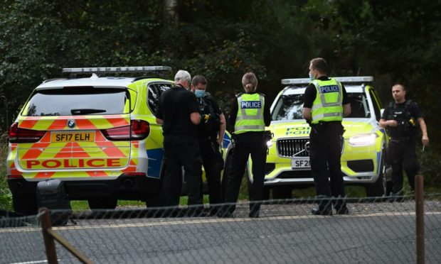 Police attending the incident at Scone Wood