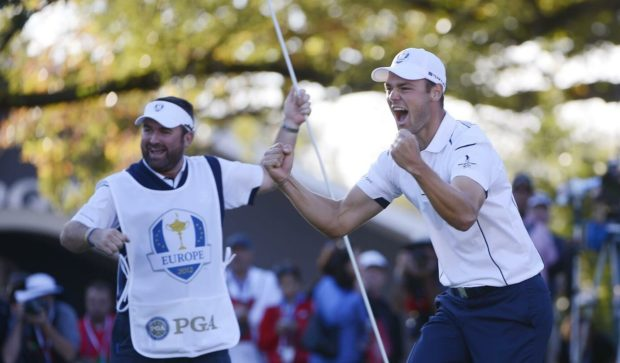 Martin Kaymer and Craig Connelly celebrate the winning putt in 2012.