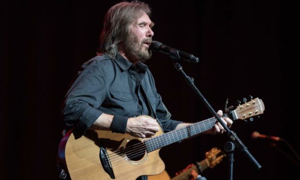 Dennis Locorriere of Dr. Hook in concert at Olympia Theatre, Dublin, Ireland.