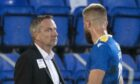 Dominik Thalhammer exchanges words with Shaun Rooney.