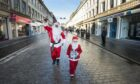People in Santa outfits taking part in the Dundee Santa Dash