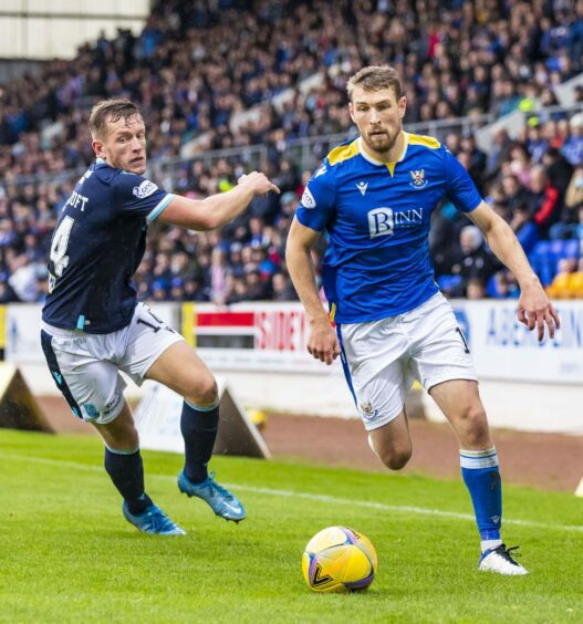 David Wotherspoon goes past Dundee's Lee Ashcroft.