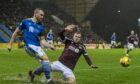 Hearts' Andy Halliday and St Johnstone's James Brown compete for the ball.