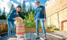 Glamis Castle's head gardener Des Cotton watches as Gayle fills an apple press. Picture: Kim Cessford.