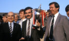 1985: Aberdeen icons Willie Miller and Sir Alex Ferguson with the Premier League trophy after presentation by league president David Letham (left).
