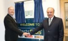 TrustFord chairman and chief executive Stuart Foulds officially opening PartsPlus Dundee alongside Kevin Magee, PartsPlus regional general manager.