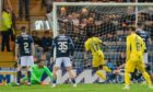 Regan Charles-Cook makes it 4-0 to Ross County.