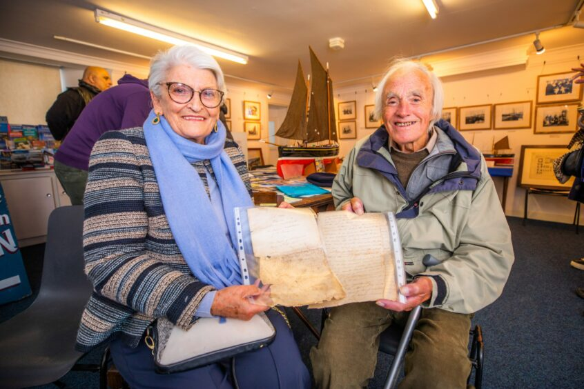 Fay Will handing over the charter to Ian Reekie (St Monans Heritage Museum)