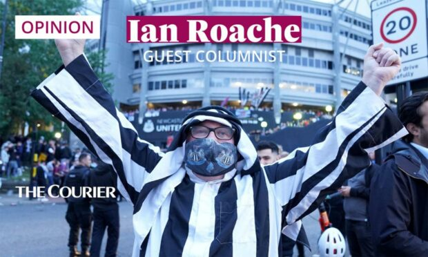 Newcastle United fans celebrate at St James' Park after the Saudi-led takeover was approved.
