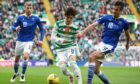 Celtic's Kyogo Furuhashi is tackled by Callum Booth.