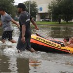 Rescuers pluck hundreds from Houston floodwaters