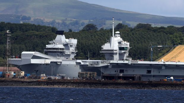 HMS Queen Elizabeth aircraft carrier prepares to leave home port
