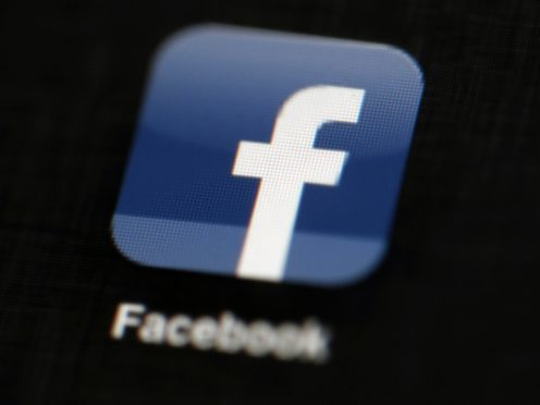 The social media giant is removing its 'trending news' feature (AP)