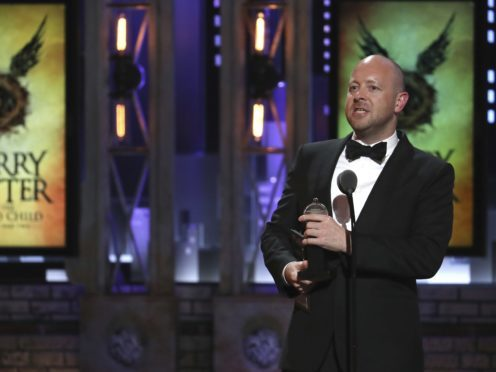 John Tiffany accepts the award for best direction of a play for Harry Potter And The Cursed Child (Michael Zorn/Invision/AP)