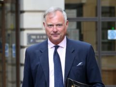 Former TV presenter John Leslie leaves Edinburgh Sheriff Court, after being acquitted of sexually assaulting a woman in an Edinburgh nightclub.