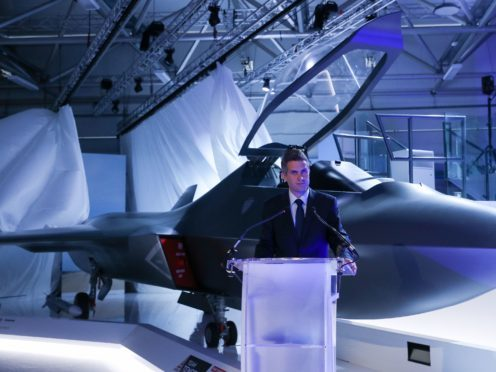 Defence Secretary Gavin Williamson unveils the new Tempest fighter jet (Andrew Matthews/PA)
