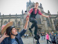 Street performers with the iZettle reader in Edinburgh (Julie Howden/iZettle)