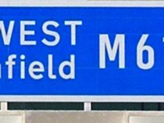 A sign on Britain's first toll motorway which will open to traffic Tuesday. The 900 million 27-mile M6 Toll north of Birmingham will be subject to a phased opening over a five-day period, and will initially be restricted to local motorists joining the route from Lichfield, Tamworth, Sutton Coldfield, Brownhills and Cannock.