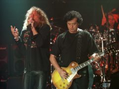 Led Zeppelin's Robert Plant, left, performs with guitarist Jimmy Page (AP Photo/Murad Sezer)