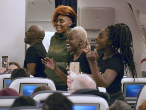 The Kingdom Choir perform Stand By Me aboard a flight to Australia (British Airways/PA)