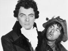 Comedy actors Rowan Atkinson (left) and Tony Robinson as Blackadder and Baldrick (PA)