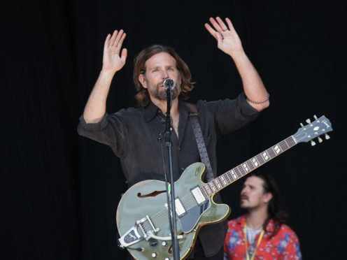 Bradley Cooper filming scenes from A Star is Born on the Pyramid Stage, before Kris Kristofferson takes to the stage, at the Glastonbury Festival (PA)