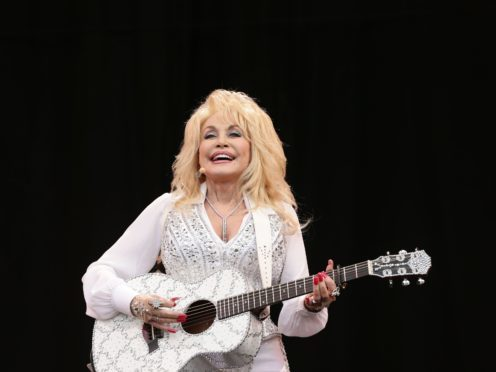 Dolly Parton has said humour is the secret of her 52-year marriage to Carl Dean (PA)