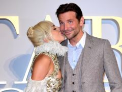 Lady Gaga and Bradley Cooper are at number one in the album and singles charts (Ian West/PA)