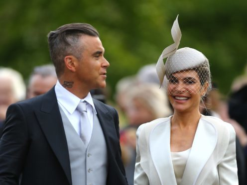 Robbie Williams and Ayda Field arrive at the wedding (Gareth Fuller/PA)