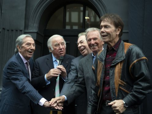 Des O'Connor, Jimmy Tarbuck, Lord Lloyd Webber, Tommy Steele and Sir Cliff Richard push the button for the curtain to drop (Victoria Jones/PA)