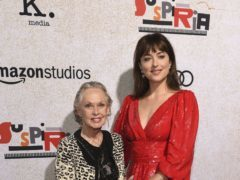 Dakota Johnson posed alongside her grandmother and Hollywood royalty Tippi Hedren at the premiere of her latest film (Chris Pizzello/Invision/AP)
