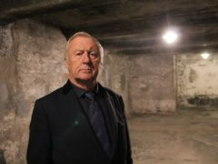 Chris Tarrant inside a gas chamber in Auschwitz (Channel 5)