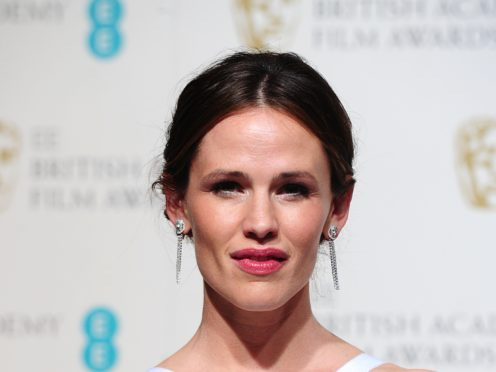 """Jennifer Garner danced a jig on her Hollywood Walk of Fame star and joked, """"it's in the contract"""" to keep the accolade (Ian West/PA)"""