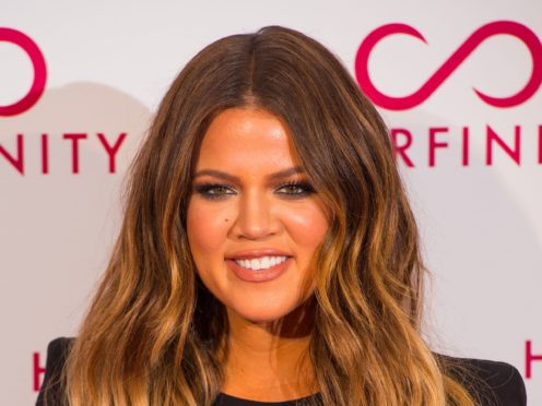 Khloe Kardashian has explained why she spent Thanksgiving away from her sisters (Dominc Lipinski/PA)