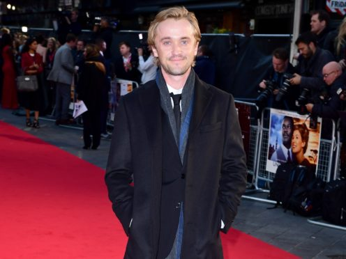 Tom Felton has said he does not try to distance himself from the character of Draco Malfoy (Ian West/PA)