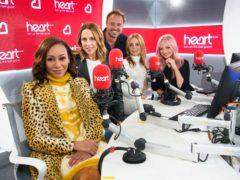 Spice Girls Melanie Brown, Melanie Chisholm, Geri Horner and Emma Bunton on the Heart Breakfast Show with host Jamie Theakston (Matt Crossick/PA)