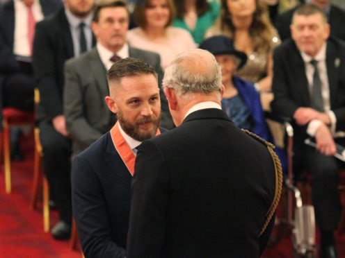 Actor Tom Hardy is made a CBE (Commander of the Order of the British Empire) by the Prince of Wales at Buckingham Palace (Yui Mok/PA)