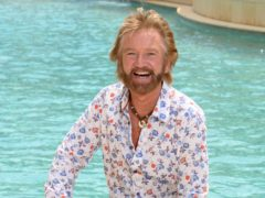 Noel Edmonds poses by the pool after being the first campmate evictedfrom the jungle (James Gourley/ITV/REX/Shutterstock)