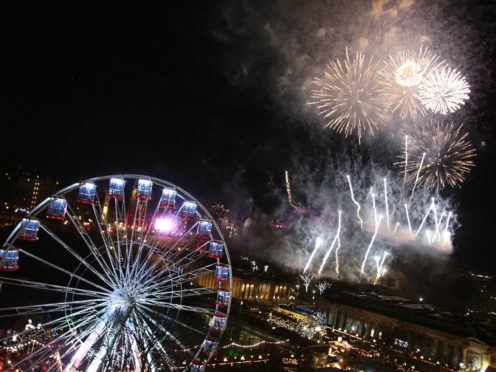 Fireworks light up the sky during the Hogmanay New Year celebrations in Edinburgh. (David Cheskin/PA)