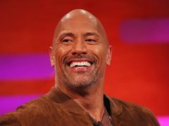Dwayne 'The Rock'Johnson shared his softer side with an adorable picture of his young daughters (Isabel Infantes/PA)