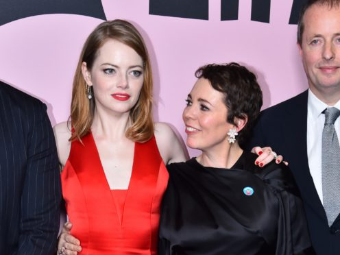 Emma Stone (left) and Olivia Colman star alongside Rachel Weisz in the black comedy about the court of Queen Anne (Matt Crossick/PA)