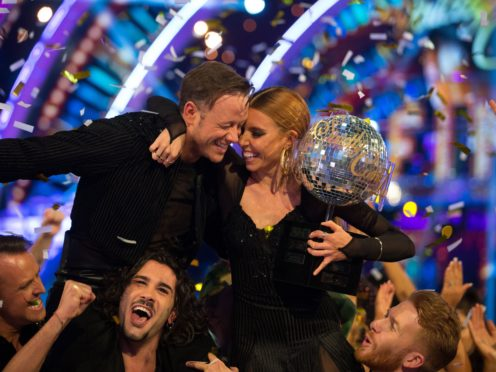 Kevin Clifton and Stacey Dooley celebrate with the glitterball trophy (Guy Levy/PA)