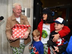 Chris Evans leaves Wogan House in London, with his wife, Natasha, and sons Noah (right) and Eli, after presenting his final BBC Radio 2 breakfast show (Kirsty O'Connor/PA)