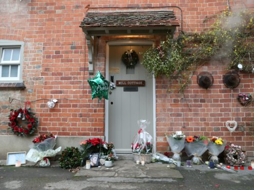 Floral tributes are left outside the home of George Michael in Goring-on-Thames, Oxfordshire (Steve Parsons/PA)
