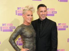 Carey Hart paid tribute to his wife Pink as the couple celebrated their 13th wedding anniversary (PA)