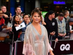 Chrissy Teigen hosted coverage of new year celebrations from Time's Square (Ian West/PA)