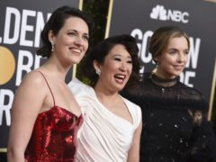 Phoebe Waller-Bridge, from left, Sandra Oh and Jodie Comer arrive at the 76th annual Golden Globe Awards at the Beverly Hilton Hotel on Sunday, Jan. 6, 2019, in Beverly Hills, Calif. (Photo by Jordan Strauss/Invision/AP)
