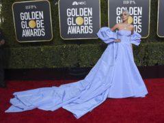 Lady Gaga arrives on the red carpet (Jordan Strauss/Invision/AP)
