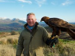 Jules Hudson with a golden eagle (BBC)