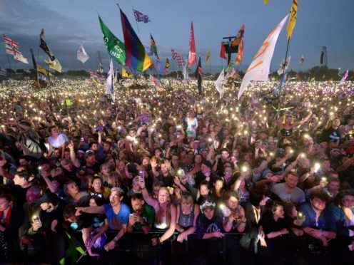 Single-use plastic bottles will no longer be sold at Glastonbury Festival (Ben Birchall/PA)